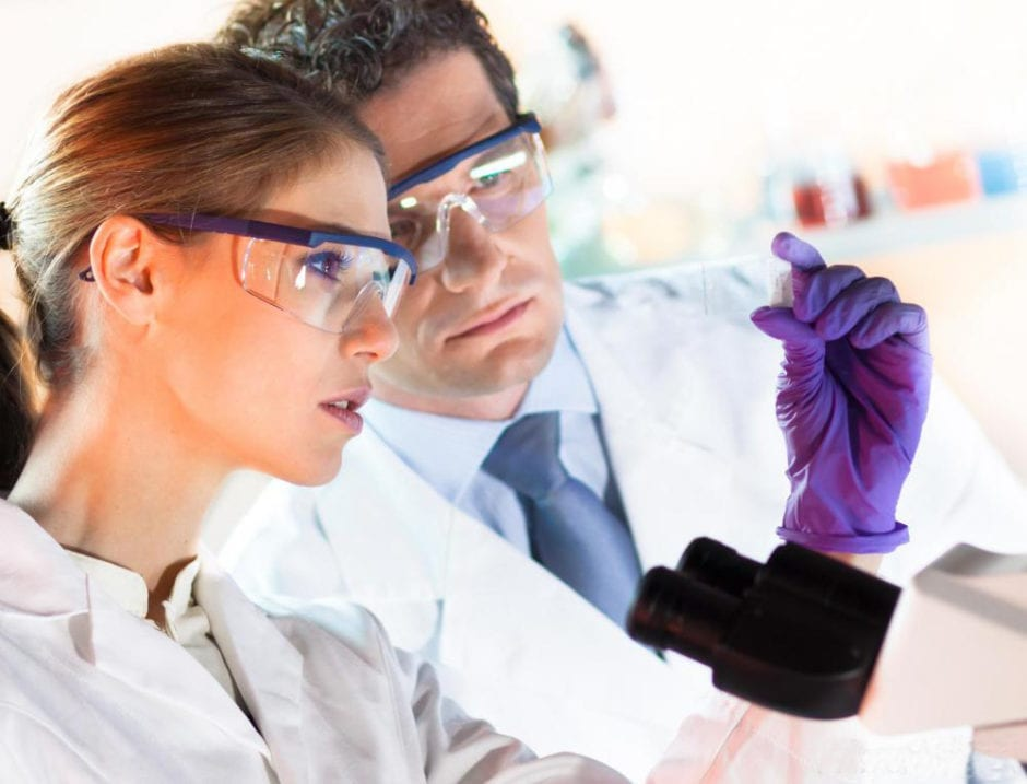two doctors looking at a test tube