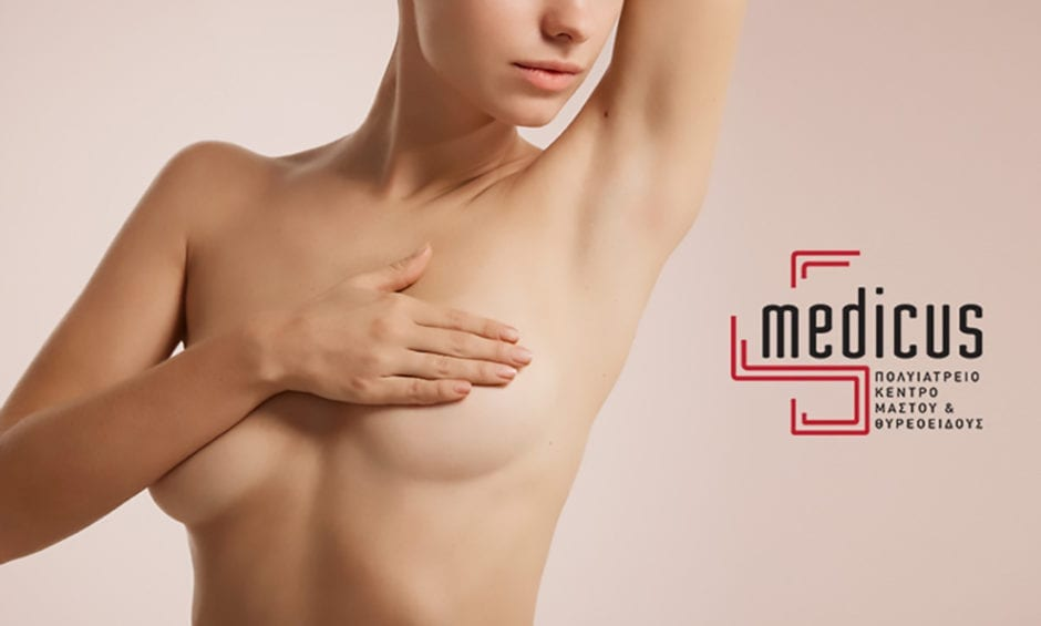woman touching her breast for breast cancer awareness
