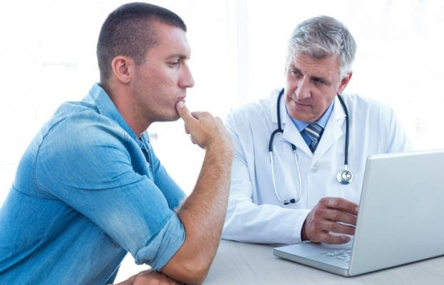 doctor speaking with patient in his office