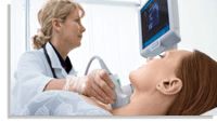 doctor checking womans throat for thyroid