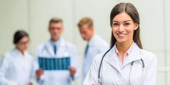 Group successful doctors in hospital background